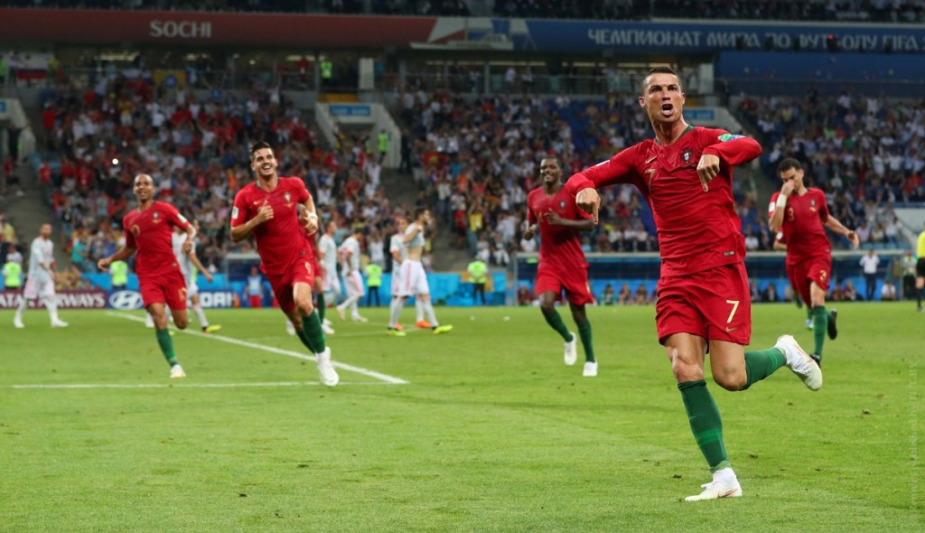 Soccer Football - World Cup - Group B - Portugal vs Spain - Fisht Stadium, Sochi, Russia - June 15, 2018   Portugal's Cristiano Ronaldo celebrates scoring their third goal with team mates   REUTERS/Hannah McKay - RC192A1C5F20
